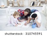 young parents playing with... | Shutterstock . vector #310745591