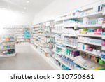 medicines arranged in shelves... | Shutterstock . vector #310750661