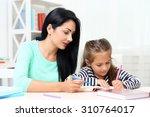 beautiful school girl doing... | Shutterstock . vector #310764017