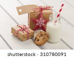 two paper parcels  christmas... | Shutterstock . vector #310780091