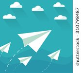 flying paper planes on the blue ... | Shutterstock .eps vector #310798487