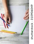 hand with color pencils and... | Shutterstock . vector #310906049