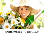 Young Blond Girl With Gardenin...