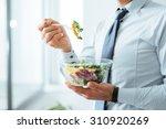 businessman having a vegetables ...   Shutterstock . vector #310920269
