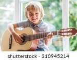 happy smiling boy learning to... | Shutterstock . vector #310945214