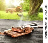 hot steak and sunny day in... | Shutterstock . vector #310965281