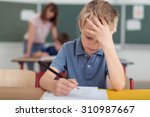 young schoolboy hard at work in ... | Shutterstock . vector #310987667