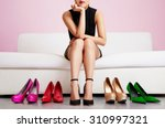 Woman Choosing Shoes Or Troubl...
