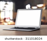 laptop on table | Shutterstock . vector #311018024