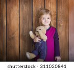 portrait of the little smiling... | Shutterstock . vector #311020841
