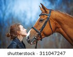 Stock photo portrait of a girl and horse 311047247