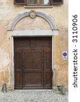 ancient wood door in saluzzo  a ... | Shutterstock . vector #3110906