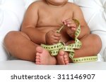adorable baby boy with a... | Shutterstock . vector #311146907