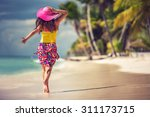Small photo of Carefree young woman relaxing on tropical beach