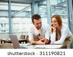 two business partners working... | Shutterstock . vector #311190821