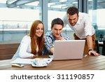 Three Web Designers Looking At...