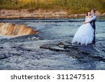 wedding couple on the nature is ... | Shutterstock . vector #311247515