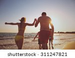 young family on the beach | Shutterstock . vector #311247821