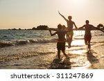 young family on the beach | Shutterstock . vector #311247869