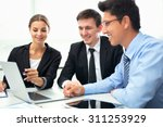 business people analyzing and... | Shutterstock . vector #311253929