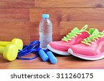sport equipment on wooden floor. | Shutterstock . vector #311260175