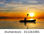 silhouette of a boy paddling at ... | Shutterstock . vector #311261081