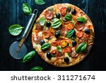 pizza with salami  olives and... | Shutterstock . vector #311271674