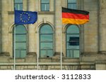 european and german flag in front of berlin reichstag - stock photo