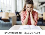 female student studying and... | Shutterstock . vector #311297195