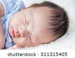 adorable newborn baby sleeping | Shutterstock . vector #311315405