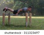 handsome muscular young man... | Shutterstock . vector #311323697