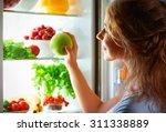 night hunger. woman in the dark ... | Shutterstock . vector #311338889