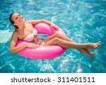 young beautiful woman is... | Shutterstock . vector #311401511