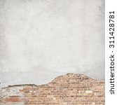 Small photo of plastered brick wall background texture, damaged plaster wall
