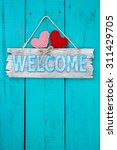 Rustic Welcome Sign With Red...