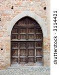 ancient wood door in saluzzo  a ... | Shutterstock . vector #3114421