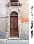 ancient wood door in saluzzo  a ... | Shutterstock . vector #3114426