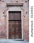 ancient wood door in saluzzo  a ... | Shutterstock . vector #3114431
