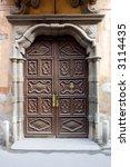 ancient wood door in saluzzo  a ... | Shutterstock . vector #3114435