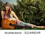 joyful hippie girl playing the... | Shutterstock . vector #311448149