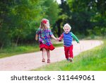 kids playing in autumn park.... | Shutterstock . vector #311449061