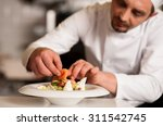 chef adding topping for smoked...   Shutterstock . vector #311542745