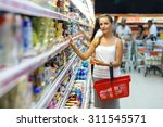 beautiful young woman shopping...   Shutterstock . vector #311545571
