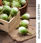 ripe eggplant on a wooden table. | Shutterstock . vector #311557544