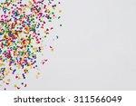 colorful celebration confetti... | Shutterstock . vector #311566049