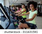 people exercising on a cardio... | Shutterstock . vector #311631581