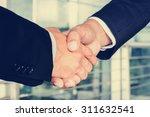 handshake of businessmen  ... | Shutterstock . vector #311632541
