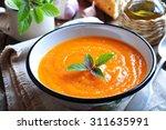 vegetarian pumpkin soup with... | Shutterstock . vector #311635991