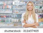 young beautiful pharmacist... | Shutterstock . vector #311657405