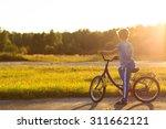 Little Boy Riding Bike At...